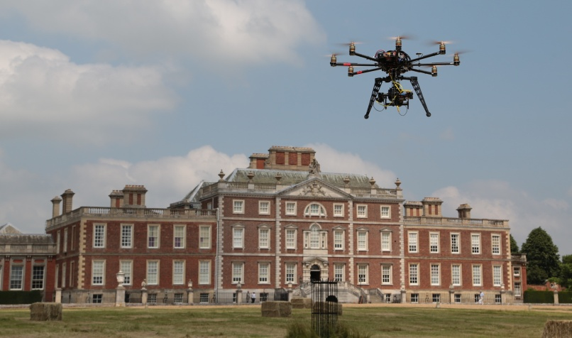Heli in front of wimple Hall Filming for 'Inside the National Trust'
